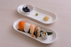 A light bites sushi option is offered to both First and Business Class customers